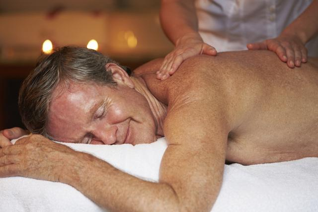Mature man receiving massage therapy